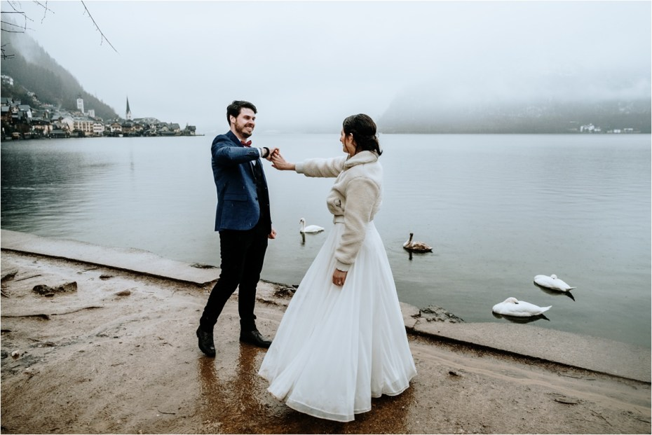 Bride and groom dance in the rain after their elopement in Hallstatt. Photos by Wild Connections Photography