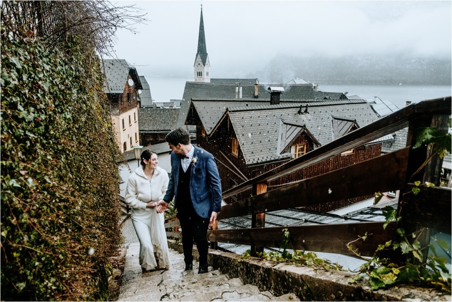 Anna & Jon climb up stairs to get the best view of Hallstatt. Photos by Wild Connections Photography