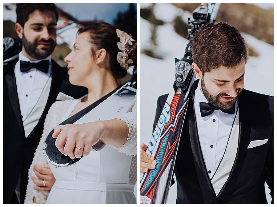 Close up of the bride and groom carrying skis