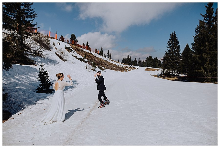 Bride and groom have a snowball fight