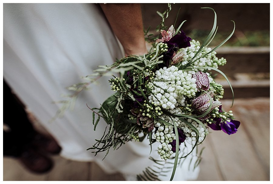 A white, green and purple bridal bouquet
