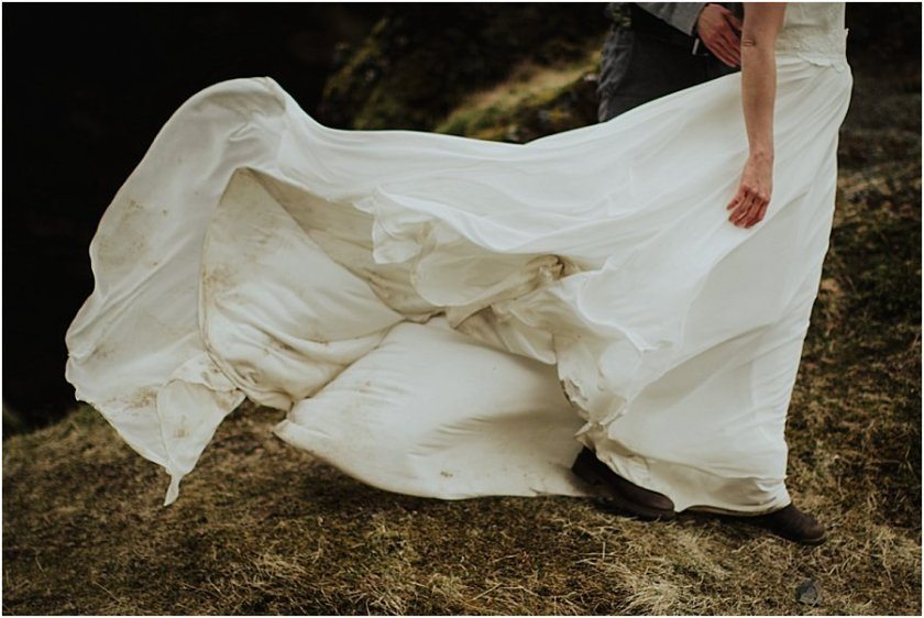 Wedding dress blowing dramatically in the wind