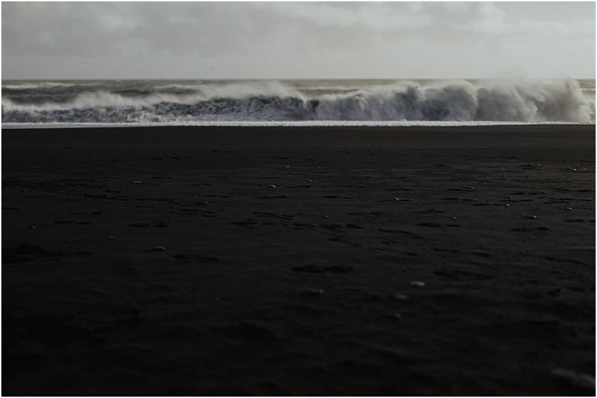 Black sand and big waves at the beach in Vik Iceland