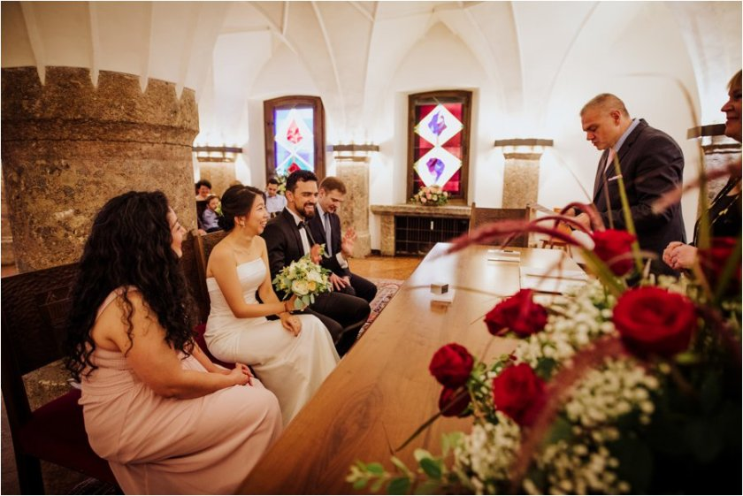 The registrar says parting words to Kelly and Arik after their civil marriage at the golden roof in Innsbruck by Wild Connections Photography