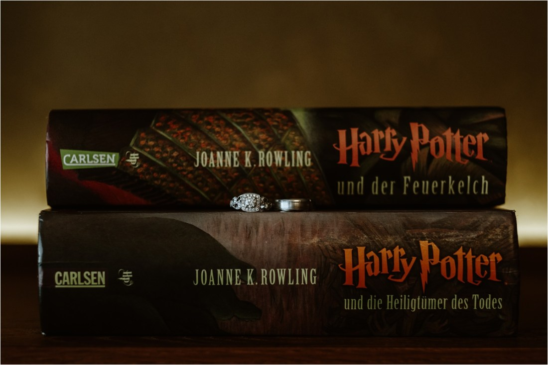 Wedding rings on Harry Potter books for this literary inspired LGBT wedding in Germany. Photo by Wild Connections Photography