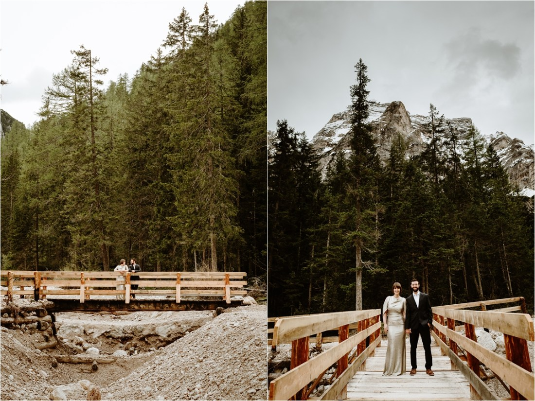 Laurel & Dustin stand on a wooden bridge over a stream in to Lake Braies in the Italian Alps. Photo by Wild Connections Photography