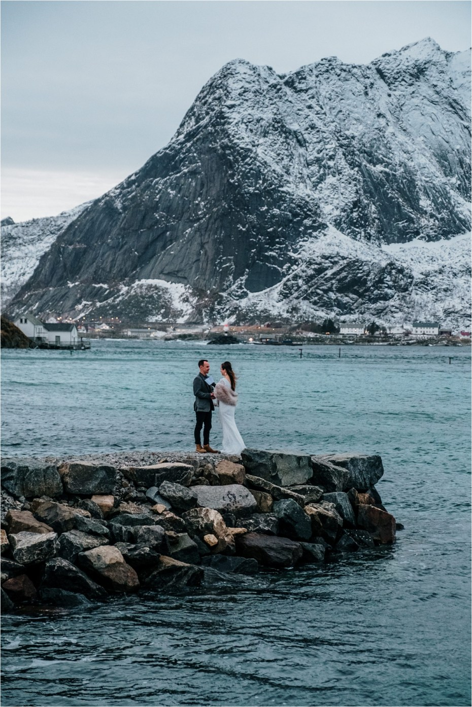 Bride and groom say their vows on a dock in Lofoten Norway. Photo by Wild Connections Photography