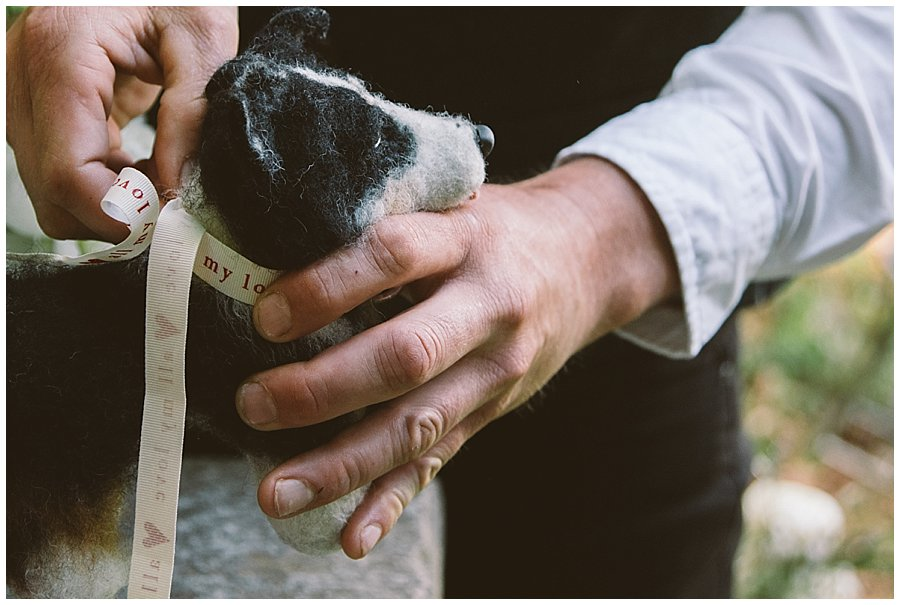St Johann in Tirol Elopement Chris takes the ring from the dog's neck by Wild Connections Photography