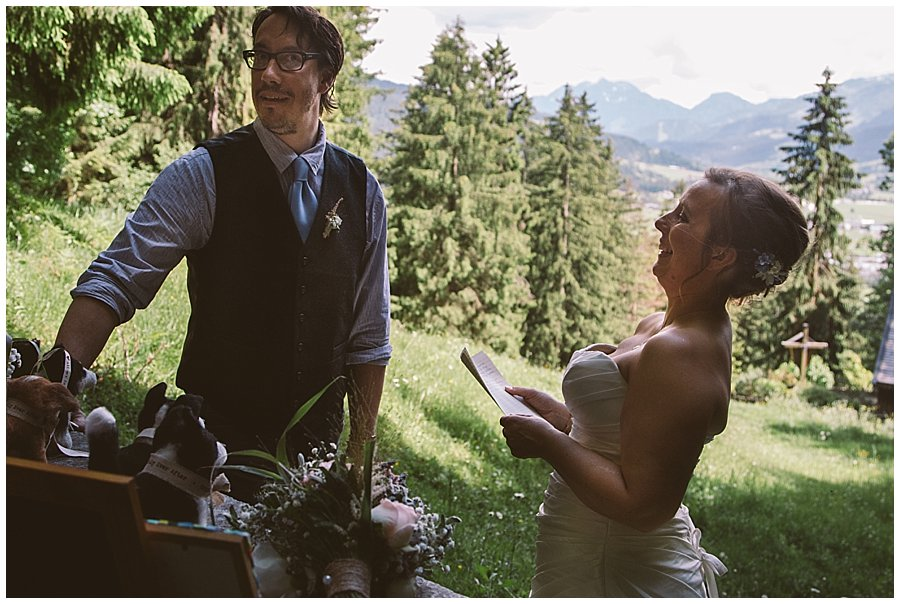St Johann in Tirol Elopement Nikki laughs as she reads her vows to Chris by Wild Connections Photography