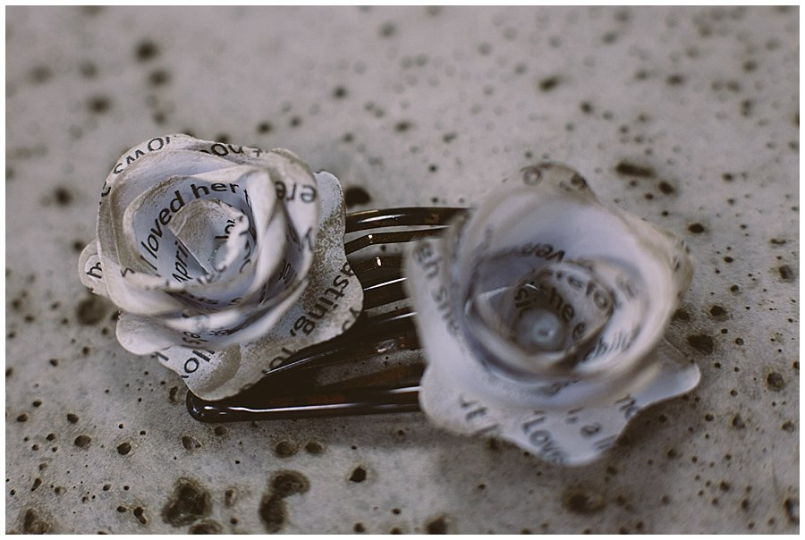 St Johann in Tirol Elopement Shakespeare sonnets rolled in to flowers on hairclips by Wild Connections Photography