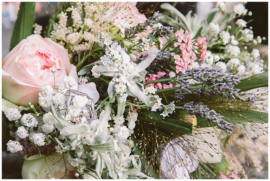St Johann in Tirol Elopement Nikki's bouquet with edelweiss, lavender and paper flowers with Shakespeare quotes by Wild Connections Photography
