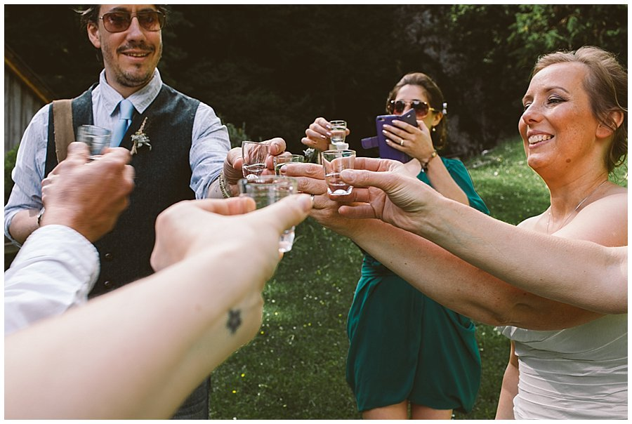 St Johann in Tirol Elopement the group toasts with a celebratory schnapps by Wild Connections Photography