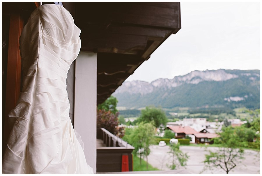 St Johann in Tirol Elopement Nikki's dress hangs on the balcony by Wild Connections Photography