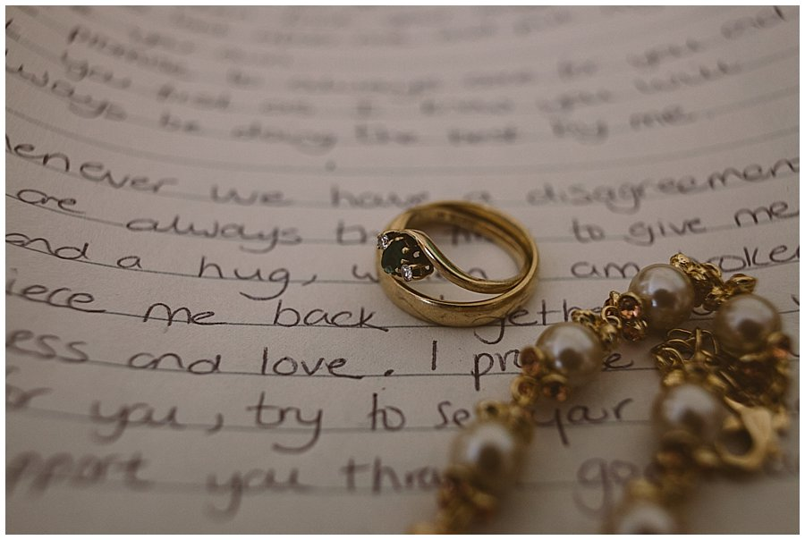 St Johann in Tirol Elopement Nikki's jewellery lies on top of her hand written vows by Wild Connections Photography