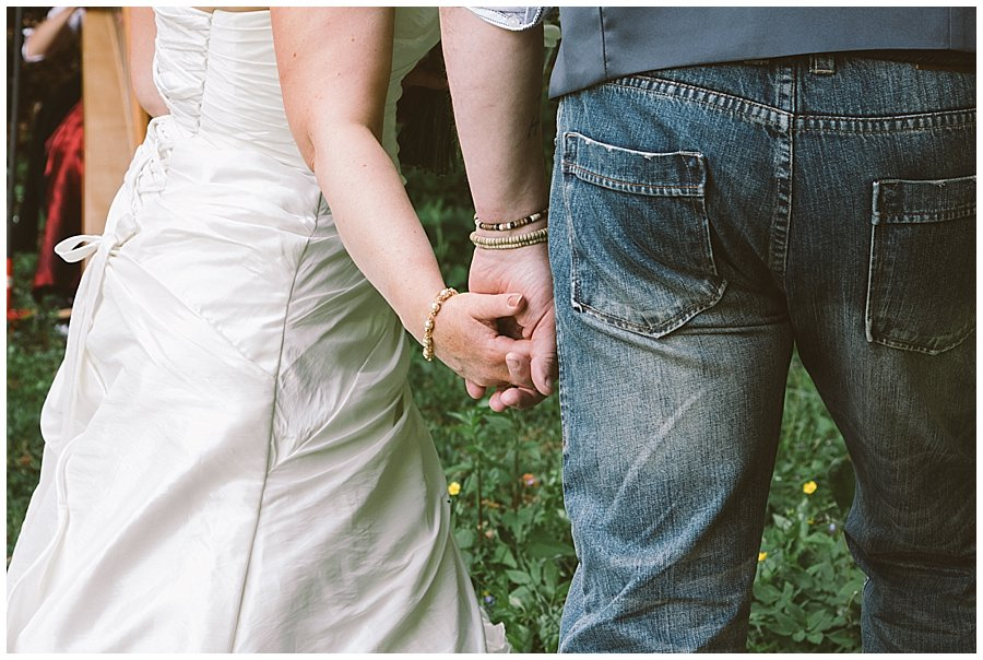 St Johann in Tirol Elopement Nikki & Chris hold hands during their elopement ceremony by Wild Connections Photography