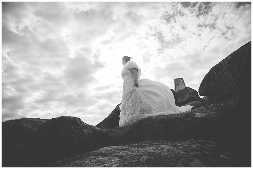 Wedding with Rescue Dogs - Black and white photo of the bride shot looking upwards by Wild Connections Photography