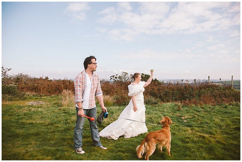 Wedding with Rescue Dogs - Husband and wife playing fetch with dogs by Wild Connections Photography