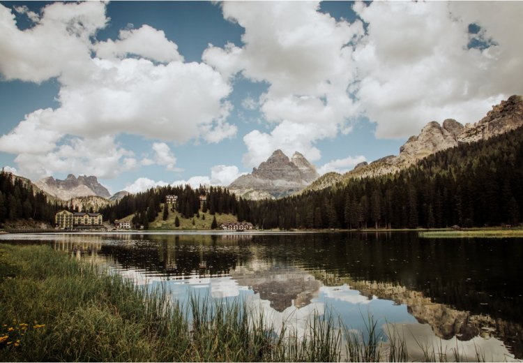 Mountain lake with reflection of mountains in the Dolomites in Italy