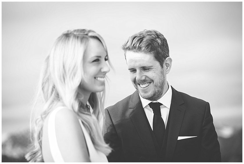 Lee and Steph smile as the celebrant tells their story