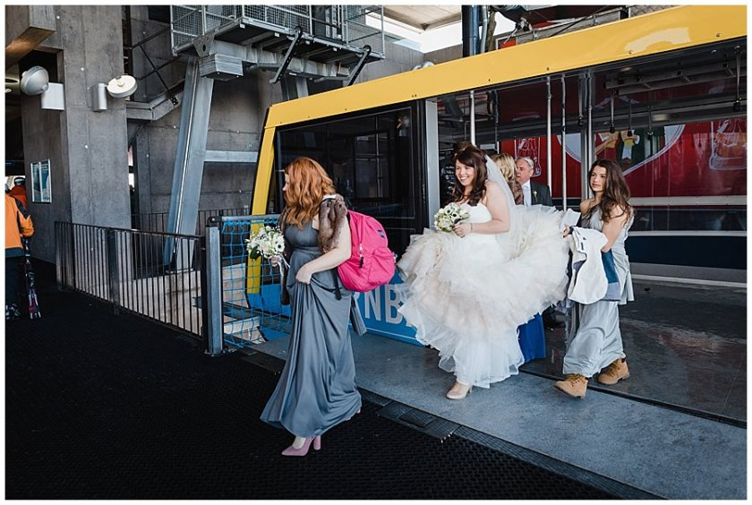 The bride arrives at the top station of the cable car