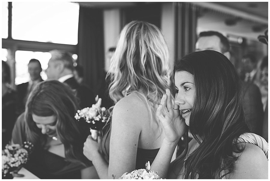 The bride's little sister wipes away a tear