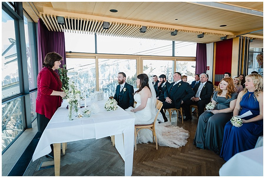 The bride and groom sit for the ceremony conducted by the Standesbeamtin from Mayrhofen