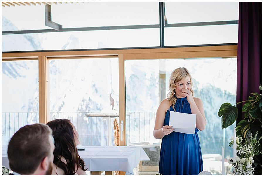 The bridesmaid Robyn gets emotional as she stands up to do a reading