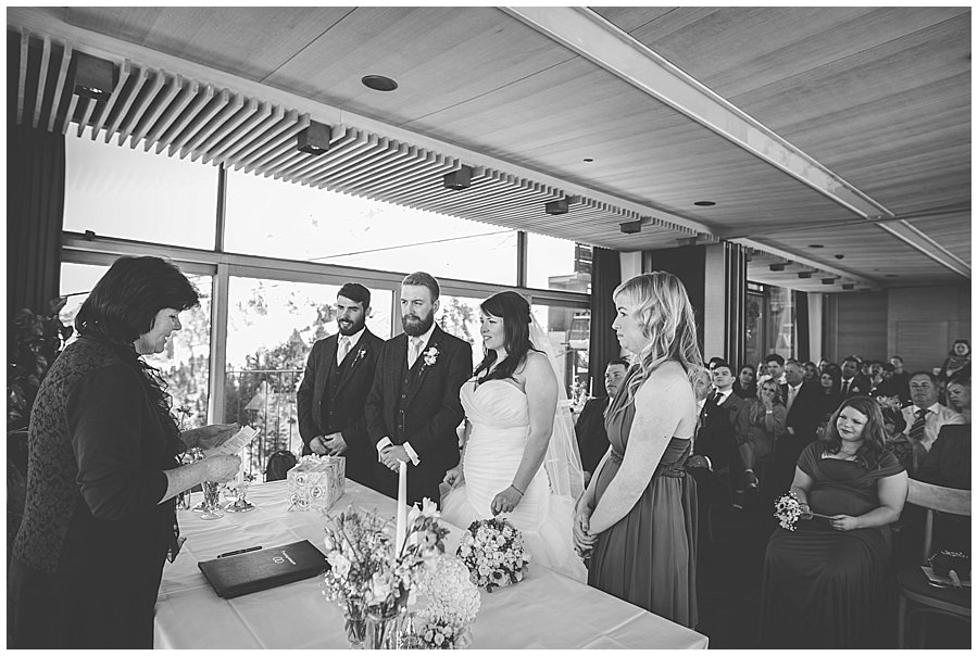 Bec and Dan stand to say their vows