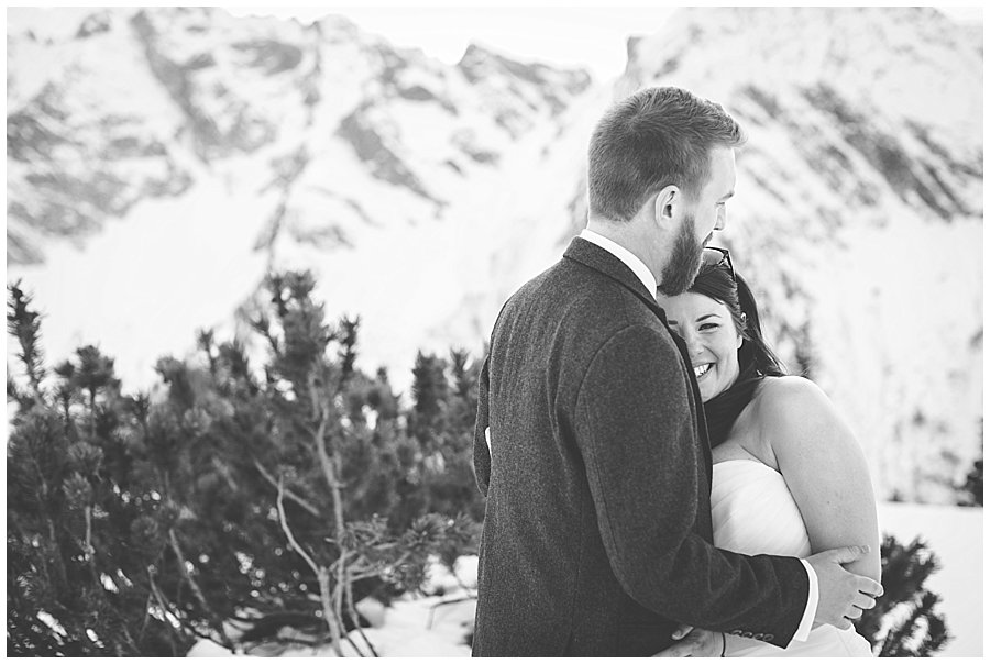 Bride leans against the groom and looks at the camera and smiles