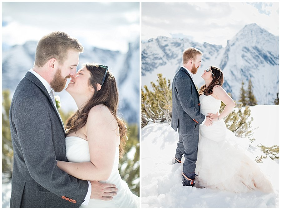 Bride and groom share a kiss in the snowy mountain landscape