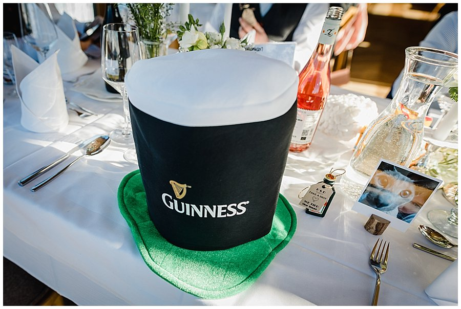 A guiness hat on the table for st patrick's day