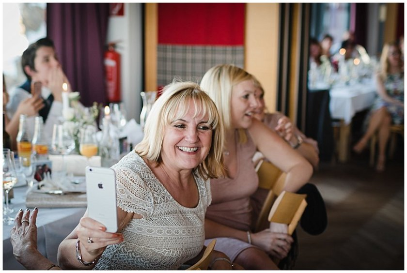A wedding guest films the speeches on her Iphone