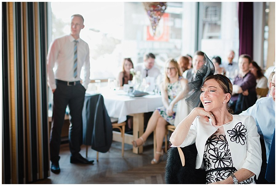 The mother of the groom laughs at the speeches