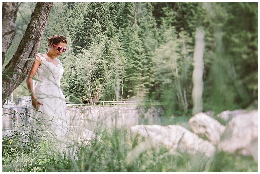 Trash The Dress Photo Shoot Austria - Bride in wedding dress and pink sunglasses by Wild Connections Photography