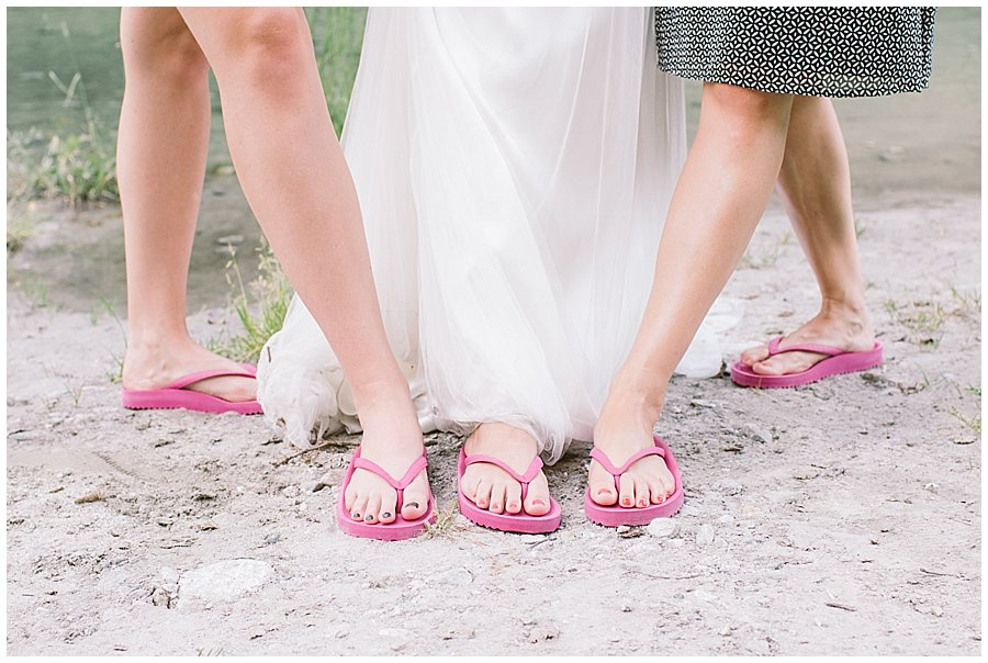 Trash The Dress Photo Shoot Austria - Bride wearing pink flipflops by Wild Connections Photography