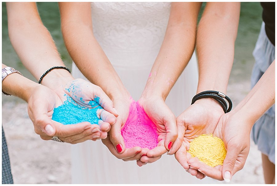 Trash The Dress Photo Shoot Austria - Close up of bride's hands with holi powder paint by Wild Connections Photography