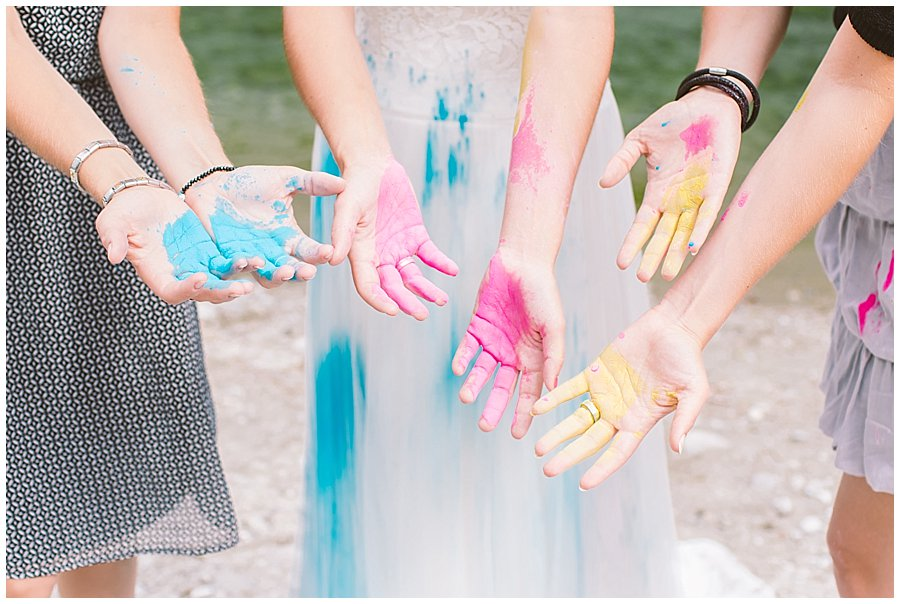 Trash The Dress Photo Shoot Austria - Close up of bride and her sisters hands with holi powder paint by Wild Connections Photography