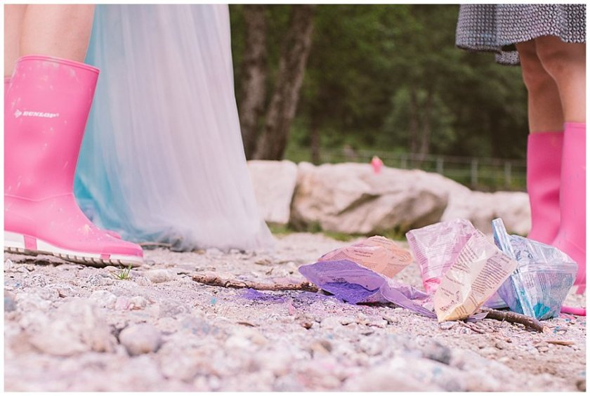 Trash The Dress Photo Shoot Austria - Bags of holi powder paint on the floor by Wild Connections Photography