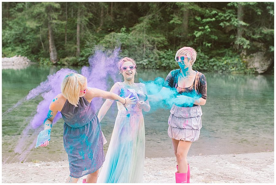 Trash The Dress Photo Shoot Austria - Bride and her sisters throwing powder paint by Wild Connections Photography