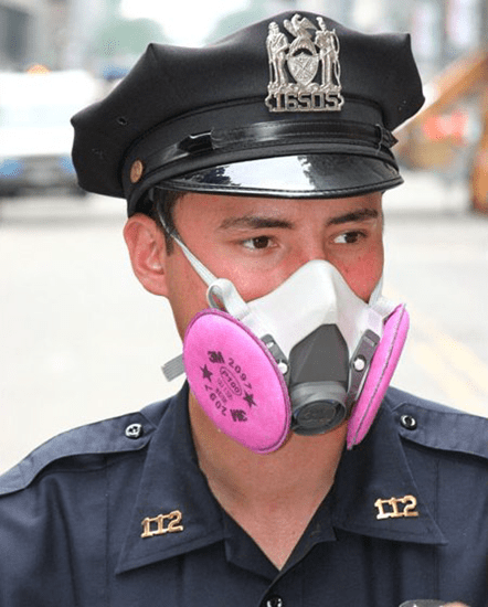 Policeman wearing air purifying particulate respirator
