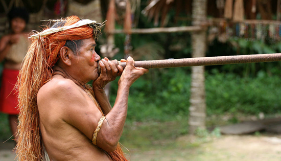 Native using a blowgun