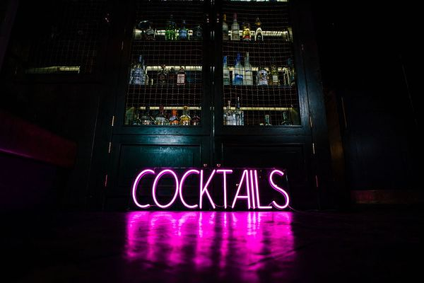 business neon cocktail sign in bar in manchester