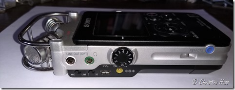Left side controls of the Sony PCM-D100, showing location of the volume knob for the speaker and headphones, and the mic/line and attenuation switches.