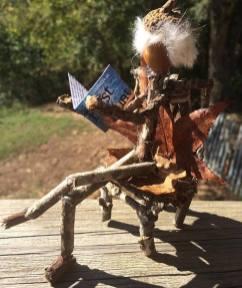 Reading Acorn Folk Man in a Chair