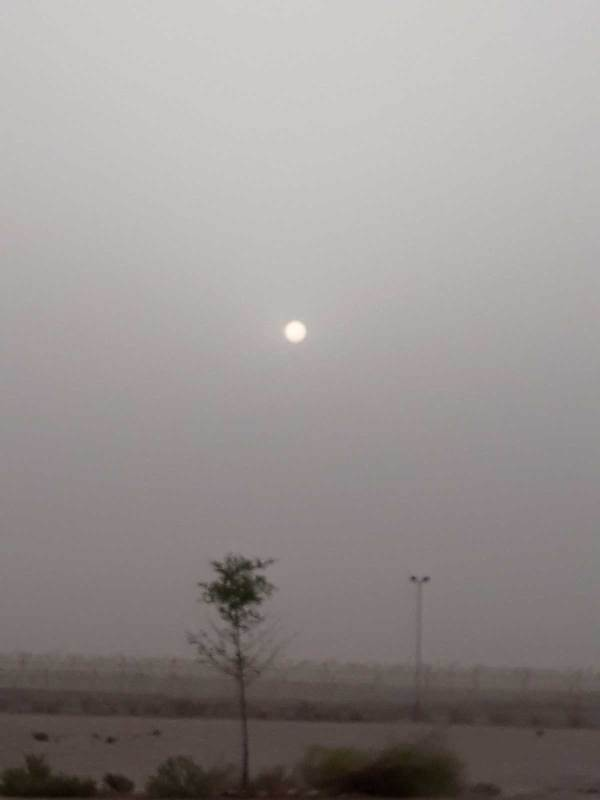 A brutal and hot, hazy day with sand and humidity in the air in Doha, Qatar.