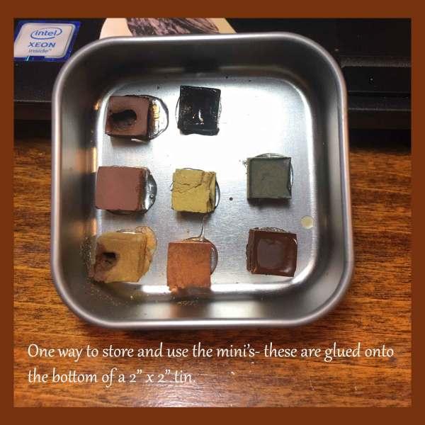 A little tin holding Paleo Paints Mini Cubes.