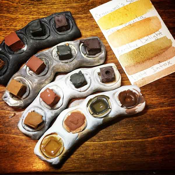 Paleo Paint Mini's in wood-fired ceramic trays. (tray color varies due to the firing method)