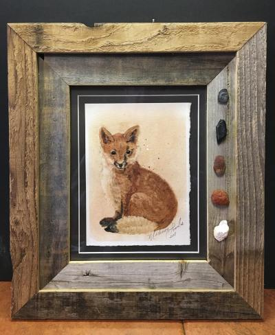 My fox painting, framed in old barnwood with rock pigment specimens.