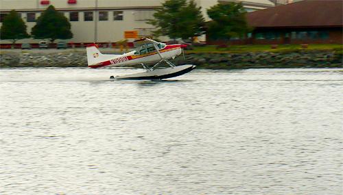 A float plane takes off from Sitka Sound near Eliason Harbor