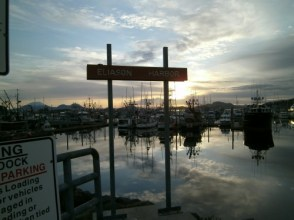 Sign at Eliason Harbor at sunset in Sitka